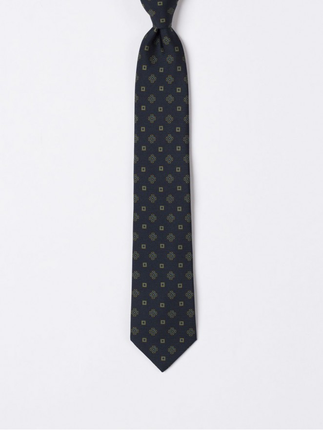 Printed silk necktie with dark blue design