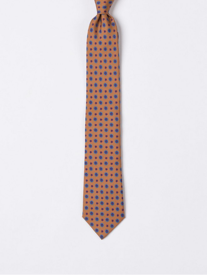 Printed silk necktie with blue flowers orange background