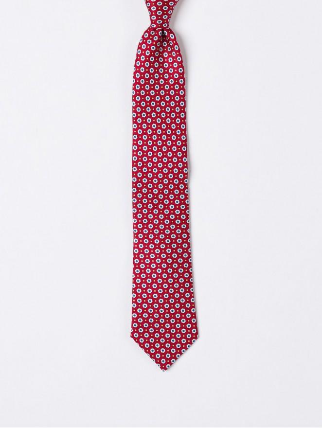Printed silk necktie with rust design